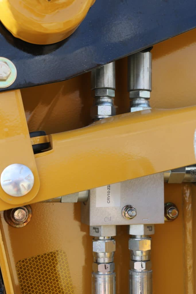The hydraulic relief valve allows for the upper beater motor to not burn out when encountering a difficult bale.